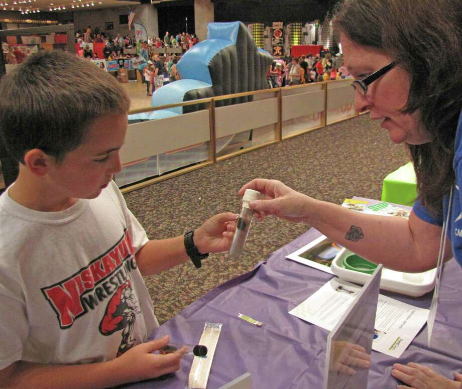 Nicholas Budka, a 6th grader from Niskayuna, examines ferrofluid.Were you Seen at the Back to School Expo at Empire State Plaza on Saturday,Sept. 8, 2012? Photo: Anne-Marie Sheehan