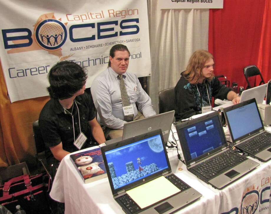 Left to right: Cameron Wallace, Matthew McCullough and Aaron Desnoyers host the booth for the Gaming, MultiMedia & Web Design program and Internet Applications program offered at Capital Region BOCES Career and Technical School. 2012 Back to School Expo at the Empire State Plaza. Photo by Anne-Marie Sheehan. Photo: Anne-Marie Sheehan