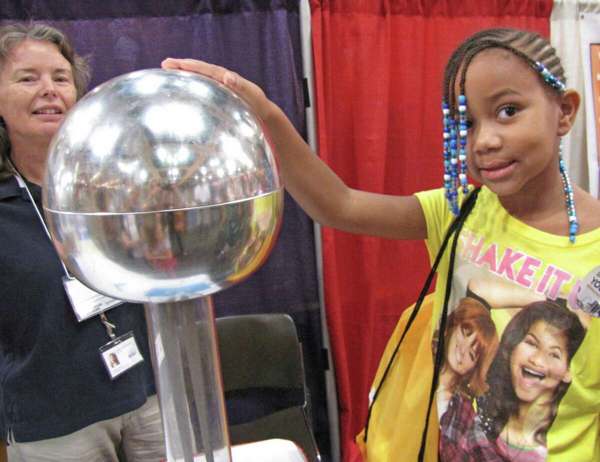 Nianna Tatro experiences the effects of static electricity by touching an electrostatic generator. Were you Seen at the Back to School Expo at Empire State Plaza on Saturday, Sept. 8, 2012?