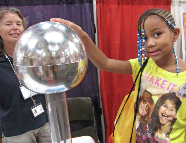 Nianna Tatro experiences the effects of static electricity by touching an electrostatic generator. W