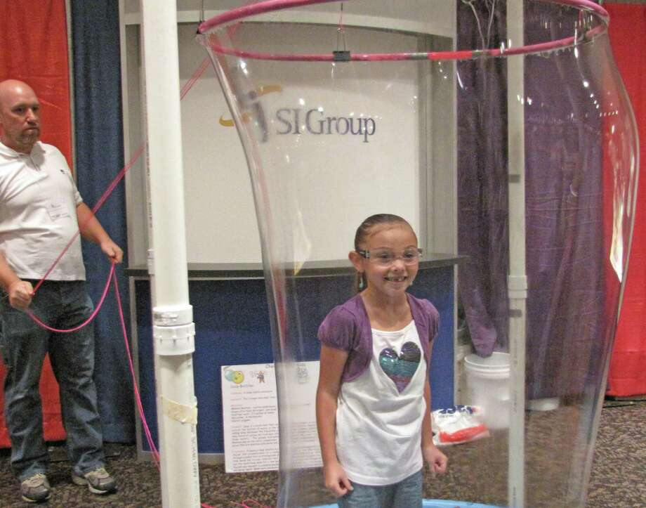 Testing out the soap bubble machine.Were you Seen at the Back to School Expo at Empire State Plaza on Saturday,Sept. 8, 2012? Photo: Anne-Marie Sheehan