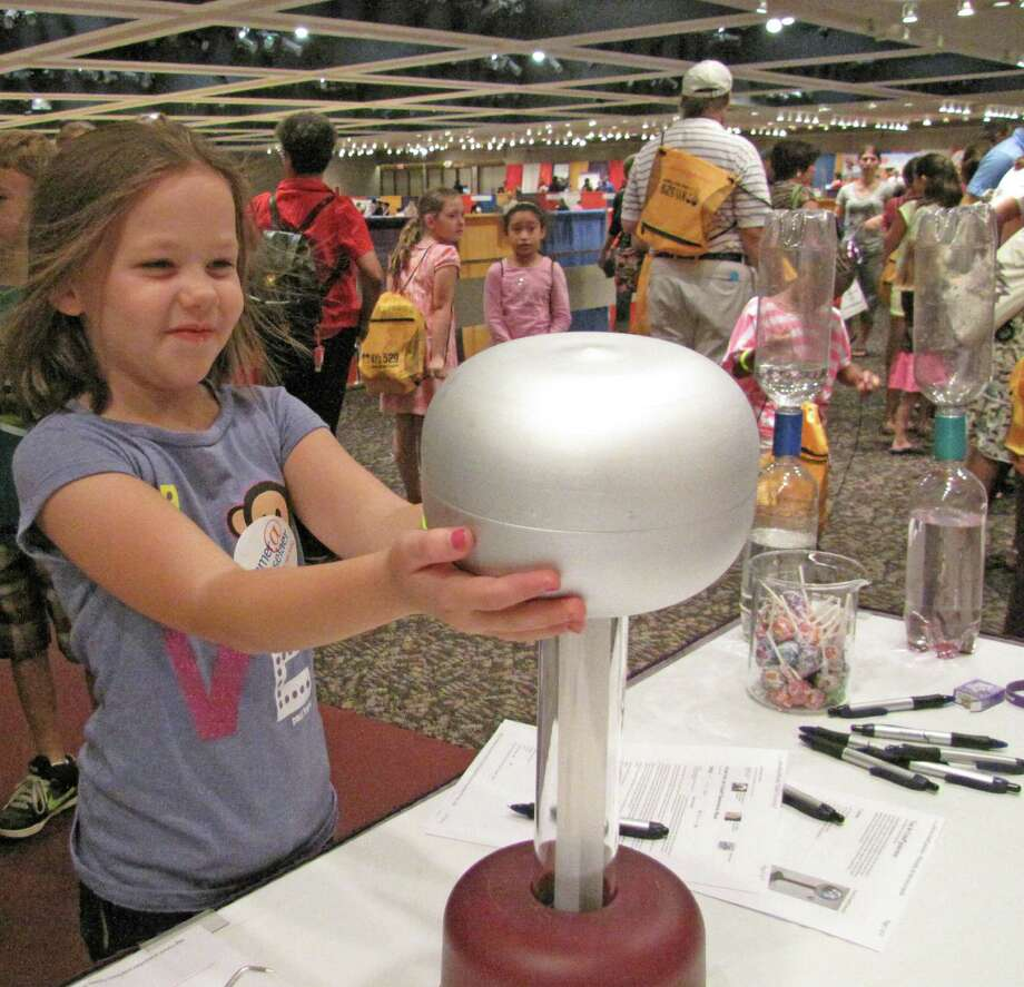 Juliana Fester of Waterford examines an electrostatic generator. 2012 Back to School Expo at the Empire State Plaza. Photo by Anne-Marie Sheehan. Photo: Anne-Marie Sheehan