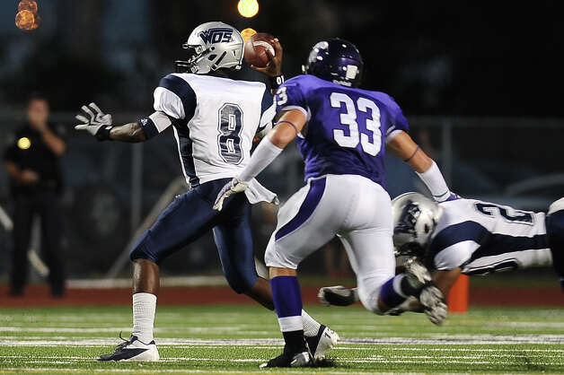 WO-S quarterback Jimmy Salter gets the ball off just in time before being sacked during the game between PN-G Indians and WO-S Mustangs at PN-G High School on Friday, September 7, 2012. Photo taken: Randy Edwards/The Enterprise Photo: Randy Edwards