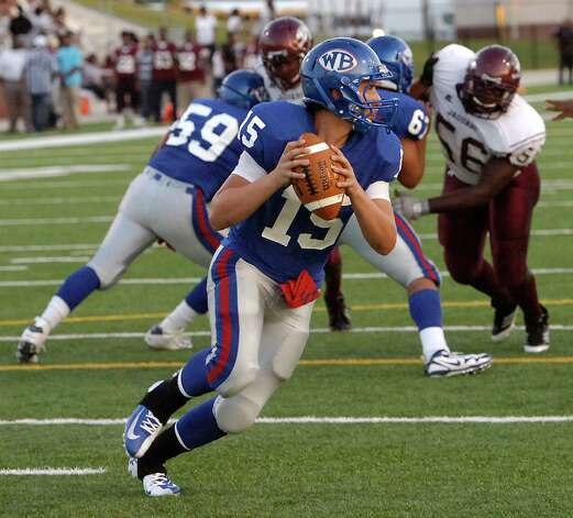 "West Brook  #15, Devin Padia, looks to throw a pass down field..   The Central Medical Magnet High School football team played West Brook High School Friday night in the second Beaumont Bowl match up at the Carrol A. ""Butch"" Thomas Educational Support Center.  Both teams entered the Friday September 7 matchup with 0-1 records.  At the half, West Brook was ahead 20-7. Dave Ryan/The Enterprise Photo: Dave Ryan"