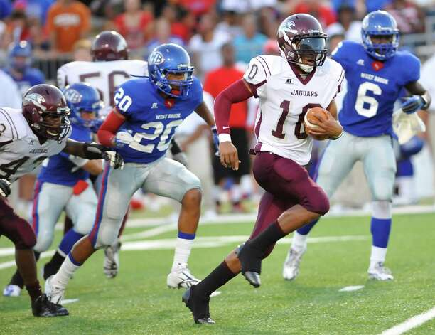 "Central #10, Garrison Mitchell, center, heads up field with West Brook  #20, Sean Square, left, tries to catch him.  The Central Medical Magnet High School football team played West Brook High School Friday night in the second Beaumont Bowl match up at the Carrol A. ""Butch Thomas Educational Support Center.  Both teams entered the Friday September 7 matchup with o-1 records.  At the half, West Brook was ahead 20-7. Dave Ryan/The Enterprise Photo: Dave Ryan"