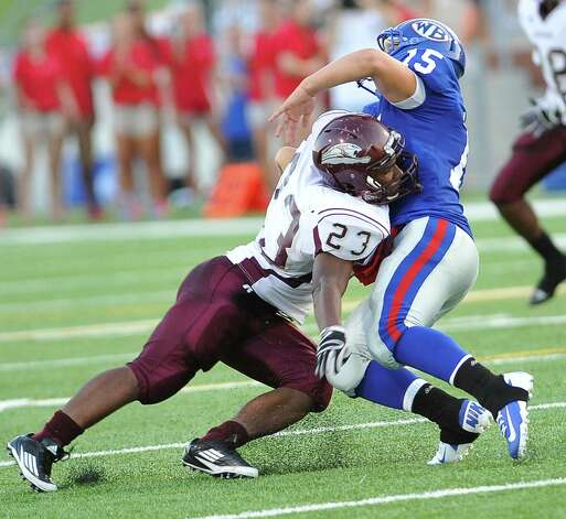 "Central #23, Trent Samuels, left, takes down West Brook ball runner #15, Devin Padia, as he heads down field.  The Central Medical Magnet High School football team played West Brook High School Friday night in the second Beaumont Bowl match up at the Carrol A. ""Butch Thomas Educational Support Center.  Both teams entered the Friday September 7 matchup with o-1 records.  At the half, West Brook was ahead 20-7. Dave Ryan/The Enterprise Photo: Dave Ryan"