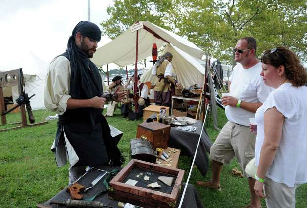 Michael Iritsky, left, talks about pirate weapons with John McGuire and Rebecca Swanson at the 35th annual norwalk Oyster Festival at Veteran's Park on Saturday, September 8, 2012. Photo: Lindsay Niegelberg / Stamford Advocate