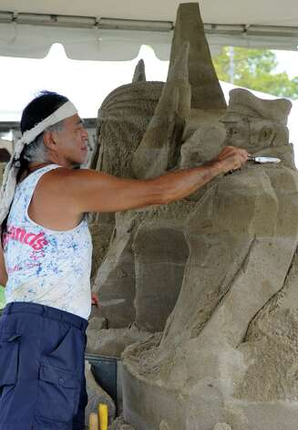An artist works on a sand sculpture at the 35th annual norwalk Oyster Festival at Veteran's Park on Saturday, September 8, 2012. Photo: Lindsay Niegelberg / Stamford Advocate