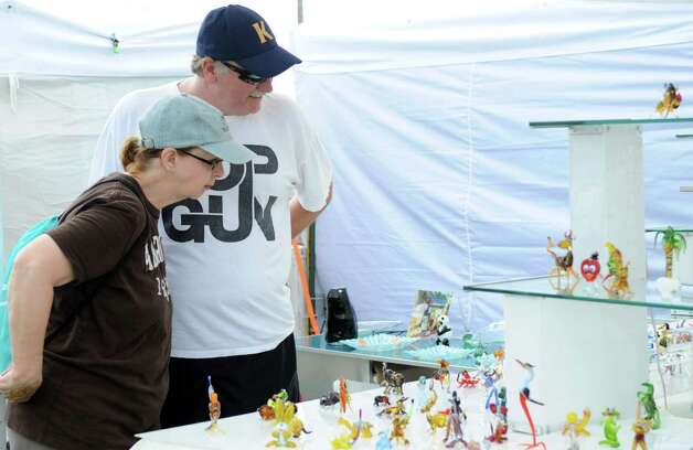 Candy and Everett Peabody of Norwalk look at glass figurines at the Art for Us Hand Blown Glass booth during the 35th annual norwalk Oyster Festival at Veteran's Park on Saturday, September 8, 2012. Photo: Lindsay Niegelberg / Stamford Advocate