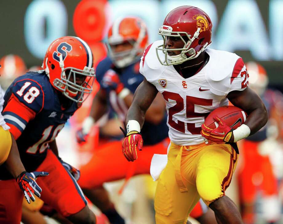 USC's Silas Redd, a Norwalk native, looks to get around Syracuse's Siriki Diabate during Saturday's game in East Rutherford, N.J. Photo: Rich Schultz, Rich Schultz/Getty Images / 2012 Getty Images