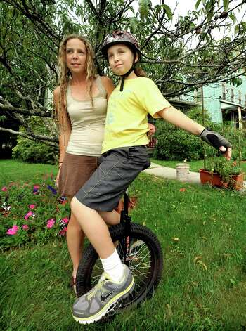 Heather Roles and her son, Elijah Crehan, 10, stand outside their Danbury home Saturday, Sept. 8, 2012. Photo: Michael Duffy
