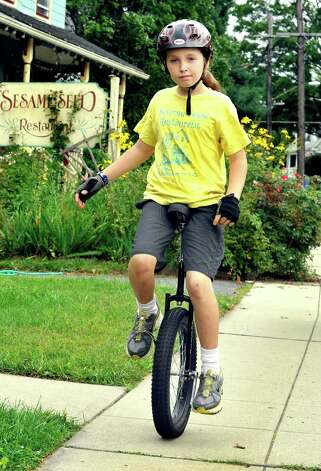 Elijah Crehan, 10, rides his unicycle in Danbury Saturday, Sept. 8, 2012. Photo: Michael Duffy / The News-Times