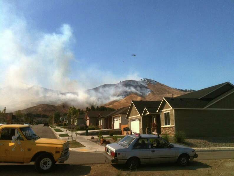 A wildfire burns in the Number One Canyon area of Wenatchee on Sunday, September 9, 2012. The fire w