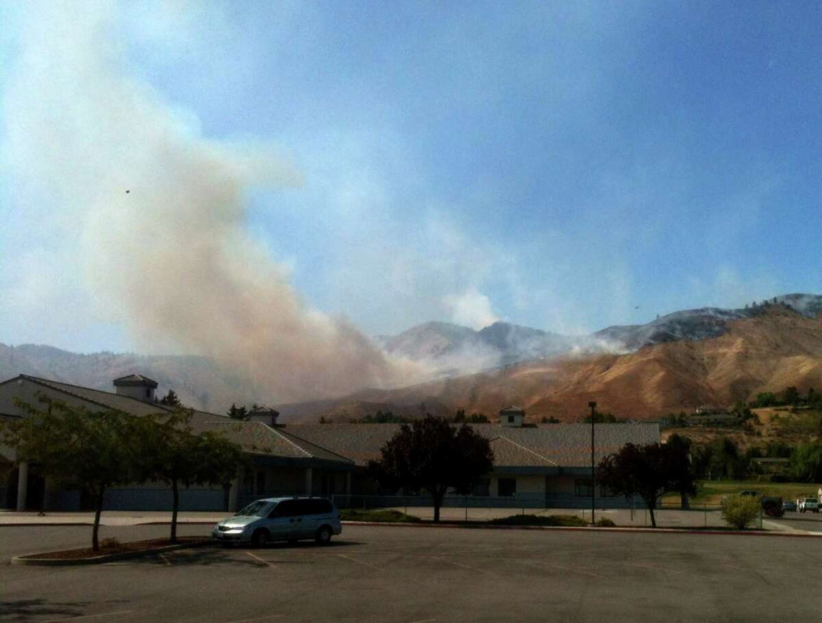 A wildfire burns in the Number One Canyon area of Wenatchee on Sunday, September 9, 2012. The fire was one of an estimated 65 wildfires started in the area by lightning and was threatening homes.