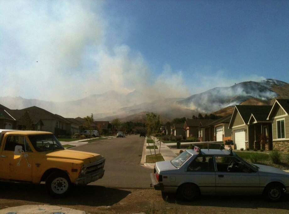 A wildfire burns in the Number One Canyon area of Wenatchee on Sunday, September 9, 2012. The fire was one of an estimated 65 wildfires started in the area by lightning and was threatening homes. Photo: Aryn Daly / Special to seattlepi.com