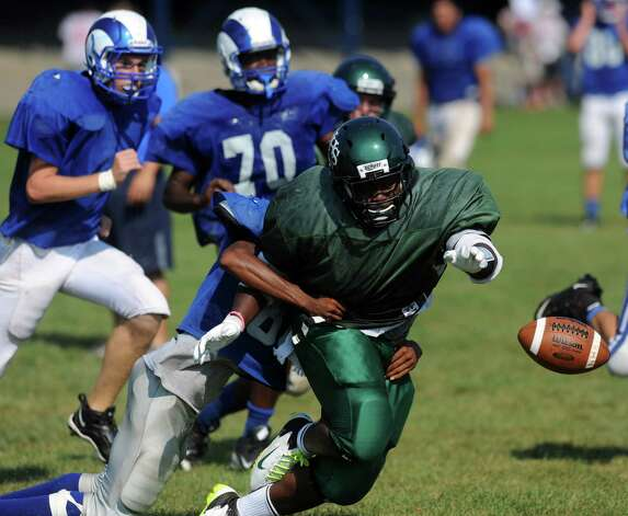 Norwalk's Tomar Joseph makes a fumble as he plays against Port Chester during the High School Football Jamboree at Veterans Memorial Stadium in Wilton on Saturday, September 1, 2012. Photo: Lindsay Niegelberg / Stamford Advocate