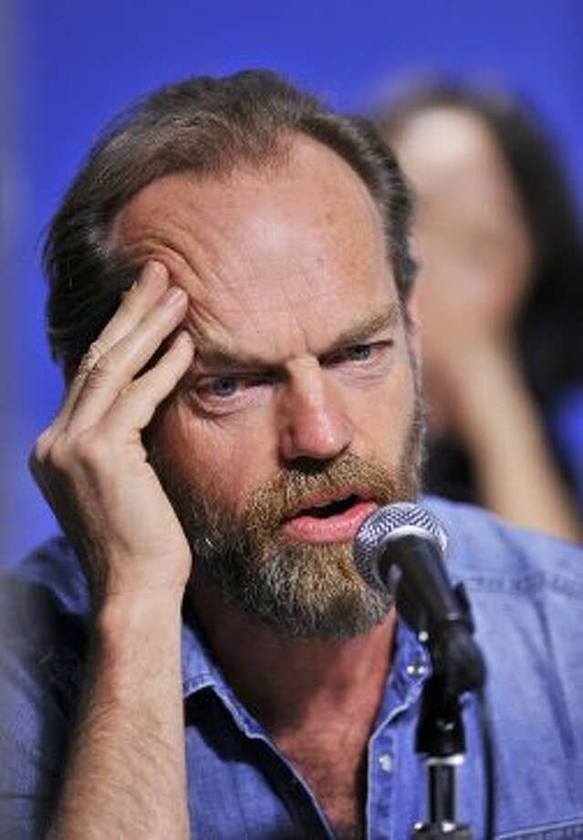 "Actor Hugo Weaving speaks during the press conference for the film ""Cloud Atlas"" during the 2012 Toronto International Film Festival in Toronto on Sunday, Sept. 9, 2012. (ASSOCIATED PRESS)"
