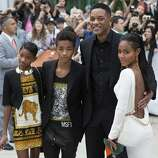 "The Smith family, from left, Willow, Jaden Will Smith and Jada Pinkett-Smith pose for a photo on the red carpet for the movie ""Free Angela and All Political Prisoners."" (AP)"