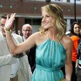 "Actress Helen Hunt waves on the red carpet for the new movie ""The Sessions."" (ASSOCIATED PRESS)"