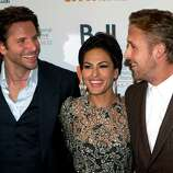 "Bradley Cooper (left), Eva Mendes and Ryan Gosling (right) share a laugh on the red carpet at the gala for the new movie ""The Place Beyond the Pines."""