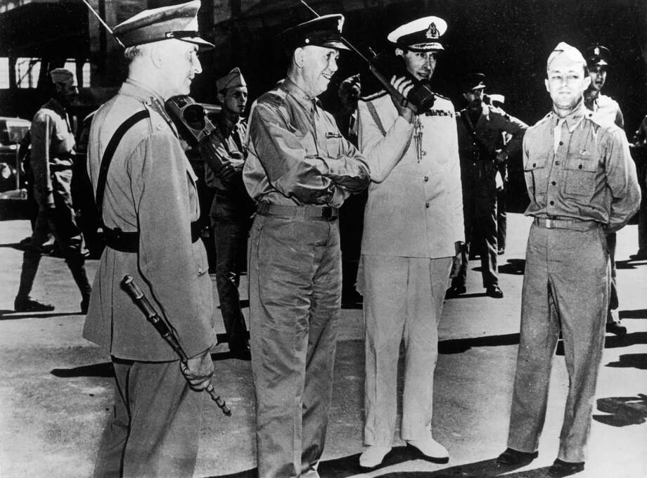 Back to real phones, this photo shows British Commander Sir John Dill and Admiral Louis Mountbatten on portable phones during World War II, circa 1942. Between them is U.S. General George Marshall. Photo: Keystone, Getty Images / 2008 Getty Images