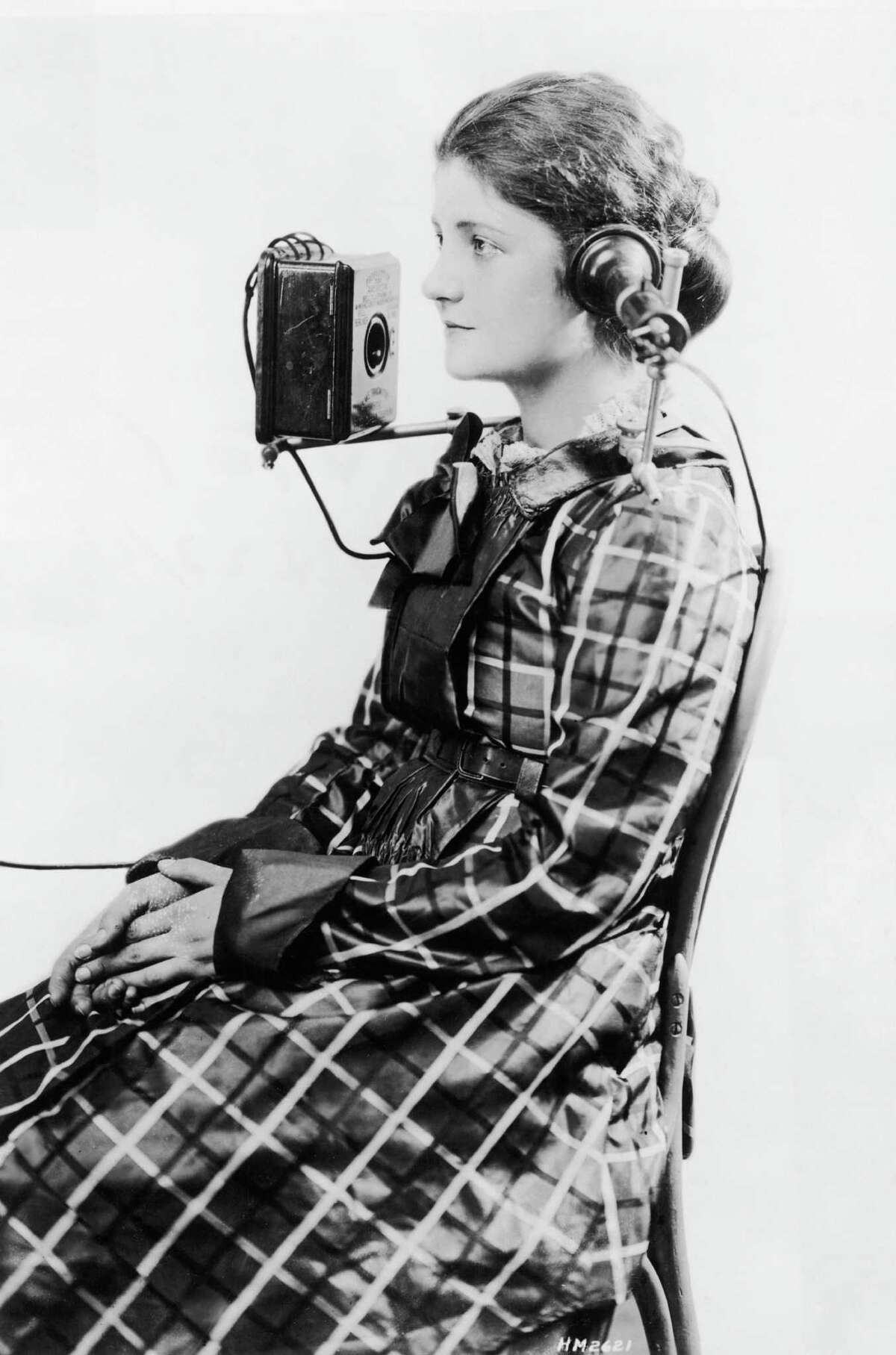 The American Bell Telephone Company devised this portable headset, shown on a telephone operator in 1923.
