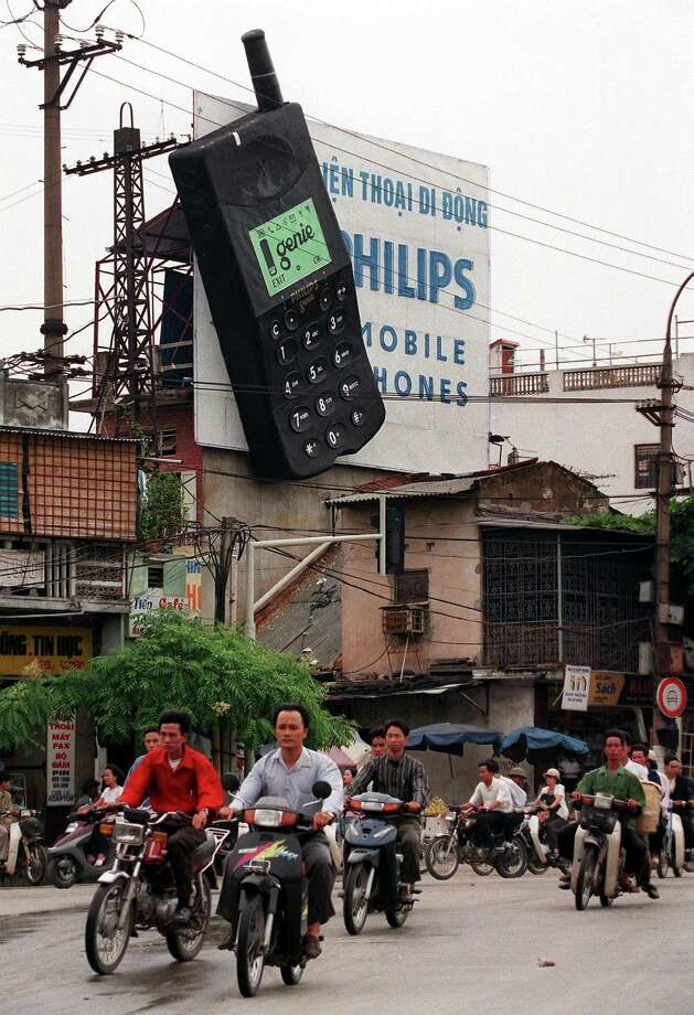 In poorer countries, many people's first-ever phone was a mobile phone. This billboard advertised Philips' mobile phone in Hanoi, Vietnam, as shown on Oct. 8, 1998.  Photo: HOANG DINH NAM, AFP/Getty Images / AFP