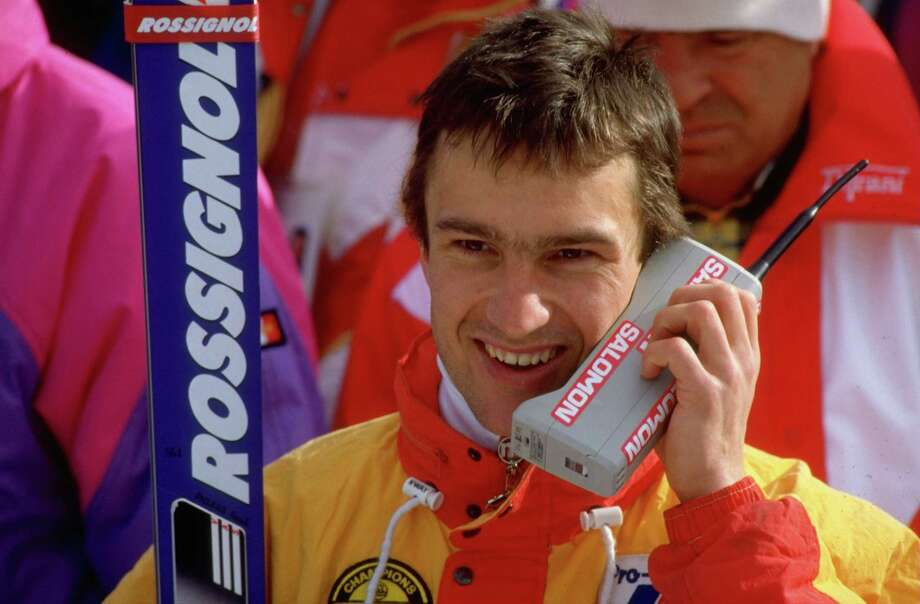 Franck Piccard of France talks on a brick-like mobile phone after winning gold in the Super G Slalom on Feb. 28, 1988  at the Winter Olympic Games in Calgary, Alberta, Canada. Photo: Getty Images / Getty Images Europe