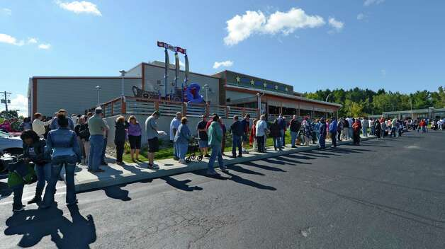 Patrons wait in line for the grand opening of  Joe's Crab Shack restaurant in Latham, N.Y.  Sept 10, 2012.     (Skip Dickstein/Times Union) Photo: Skip Dickstein / 00019203A