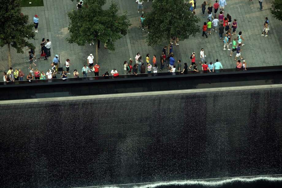 The reflective pool at The National September 11 Memorial Museum is viewed on September 7, 2012 in New York City. As New York City and the country prepare for the 11th anniversary of the September 11, 2001 terrorist attacks, work proceeds at the former site of the World Trade Center Towers. The 16-acre site, which is owned by the Port Authority of New York and New Jersey and is being rebuilt with developer Larry Silverstein, has a projected price tag of $14.8 billion. Of the four office towers planned for the site, two have had finishing beams placed on their top floors and the above-ground memorial was completed in time for the 10th anniversary last year. Photo: Spencer Platt / Getty Images