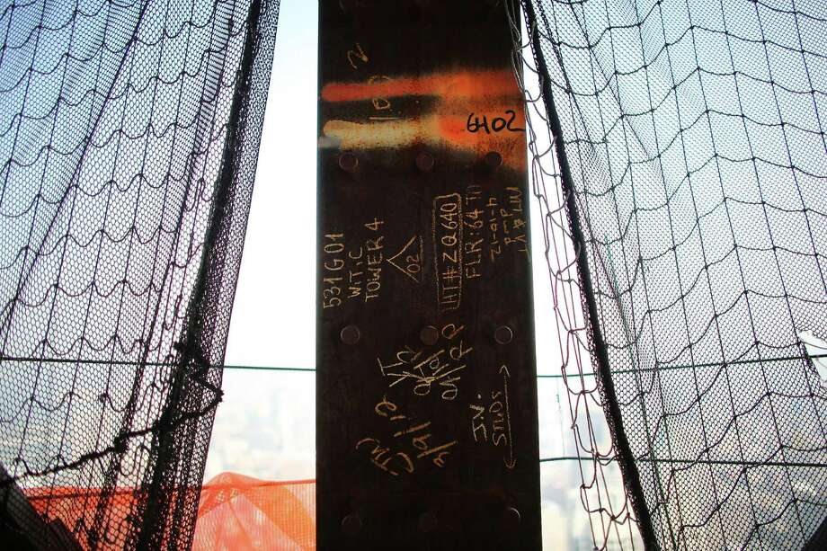 Writing is viewed on a beam on the 72nd floor at Four World Trade Center on September 7, 2012 in New York City. As New York City and the country prepare for the 11th anniversary of the September 11, 2001 terrorist attacks, work proceeds at the former site of the World Trade Center Towers. The 16-acre site, which is owned by the Port Authority of New York and New Jersey and is being rebuilt with developer Larry Silverstein, has a projected price tag of $14.8 billion. Of the four office towers planned for the site, two have had finishing beams placed on their top floors and the above-ground memorial was completed in time for the 10th anniversary last year. Photo: Spencer Platt / Getty Images