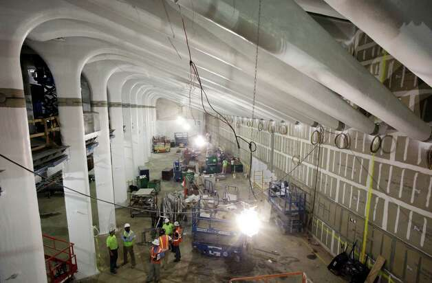 Construction continues beneath the arched columns of the East-West Corridor at the World Trade Center site, in New York. The subterranean corridor will connect several buildings with the transportation hub. Photo: Mark Lennihan / Associated Press