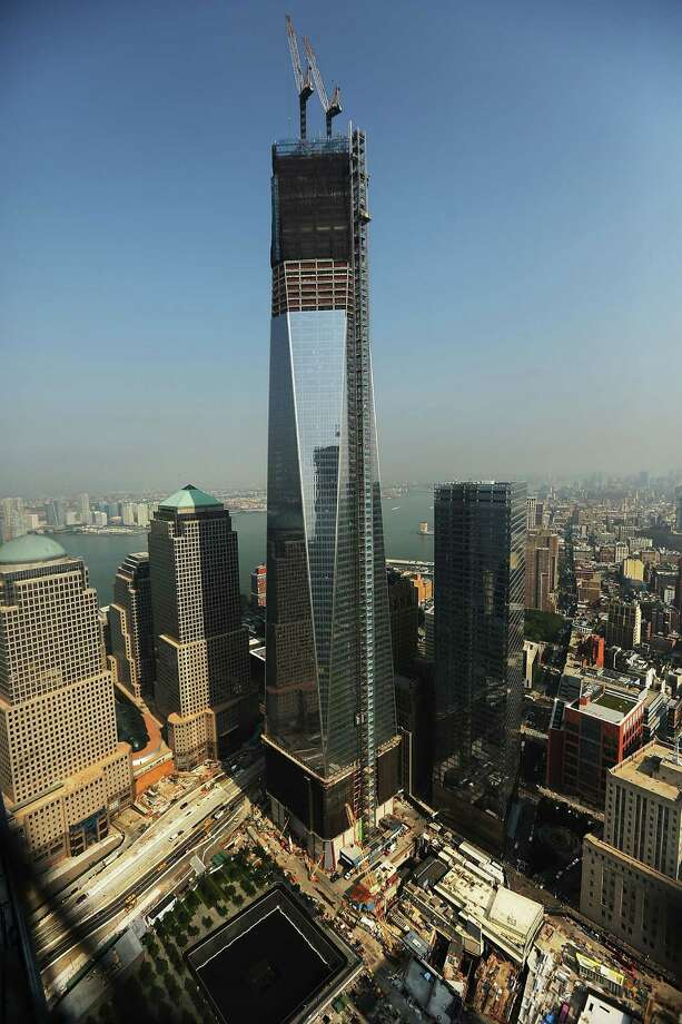 One World Trade Center is viewed from the 72nd floor of Four World Trade Center on September 7, 2012 in New York City. As New York City and the country prepare for the 11th anniversary of the September 11, 2001 terrorist attacks, work proceeds at the former site of the World Trade Center Towers. The 16-acre site, which is owned by the Port Authority of New York and New Jersey and is being rebuilt with developer Larry Silverstein, has a projected price tag of $14.8 billion. Of the four office towers planned for the site, two have had finishing beams placed on their top floors and the above-ground memorial was completed in time for the 10th anniversary last year. Photo: Spencer Platt / Getty Images