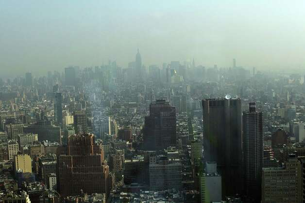 Part of Manhattan is viewed from the 72nd floor of Four World Trade Center on September 7, 2012 in New York City. As New York City and the country prepare for the 11th anniversary of the September 11, 2001 terrorist attacks, work proceeds at the former site of the World Trade Center Towers. The 16-acre site, which is owned by the Port Authority of New York and New Jersey and is being rebuilt with developer Larry Silverstein, has a projected price tag of $14.8 billion. Of the four office towers planned for the site, two have had finishing beams placed on their top floors and the above-ground memorial was completed in time for the 10th anniversary last year. Photo: Spencer Platt / Getty Images