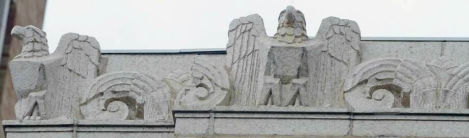 Just below the roof line on parts of the old Jefferson County Courthouse are what appears to be sculpted eagles that adorn the frontage as well as the corners of the buildings.  This photograph was taken January 6, 2012. Dave Ryan/The Enterprise