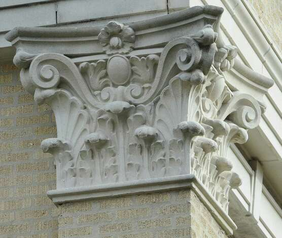 Different then the caps on the pillars of the First Baptist Church building, this work can be seen on the old city hall and auditorium building in downtown, better known as the Julie Rogers Theatre for the Performing Arts.   This photograph was taken January 6, 2012. Dave Ryan/The Enterprise