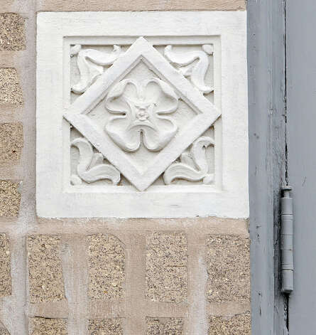 The Temple Emanuel, built sometime in 1923, has these ornate blocks embedded in the brick around the front entrance.  This photograph was taken January 6, 2012.    Dave Ryan/The Enterprise