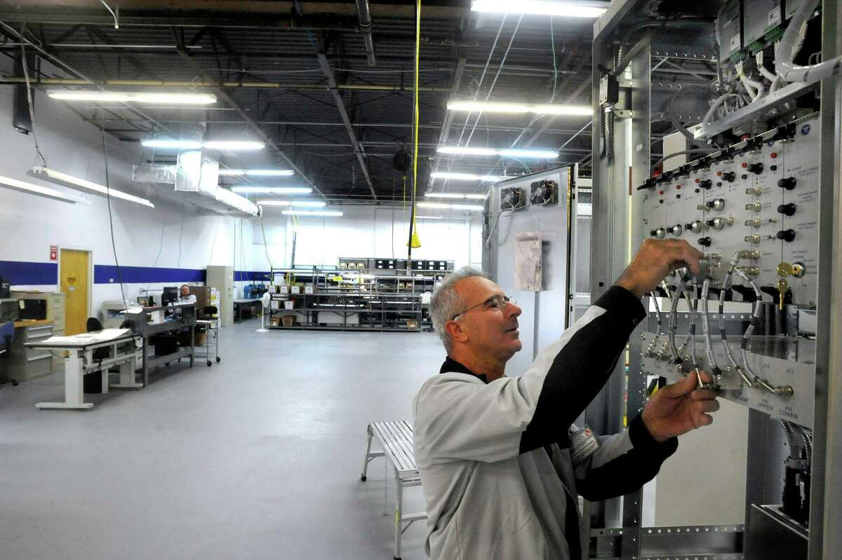 Joe Scarpelli builds a nuclear power control panel in Kimchuk's new System Intregration 2 facility in Danbury Monday, Sept. 10, 2012.