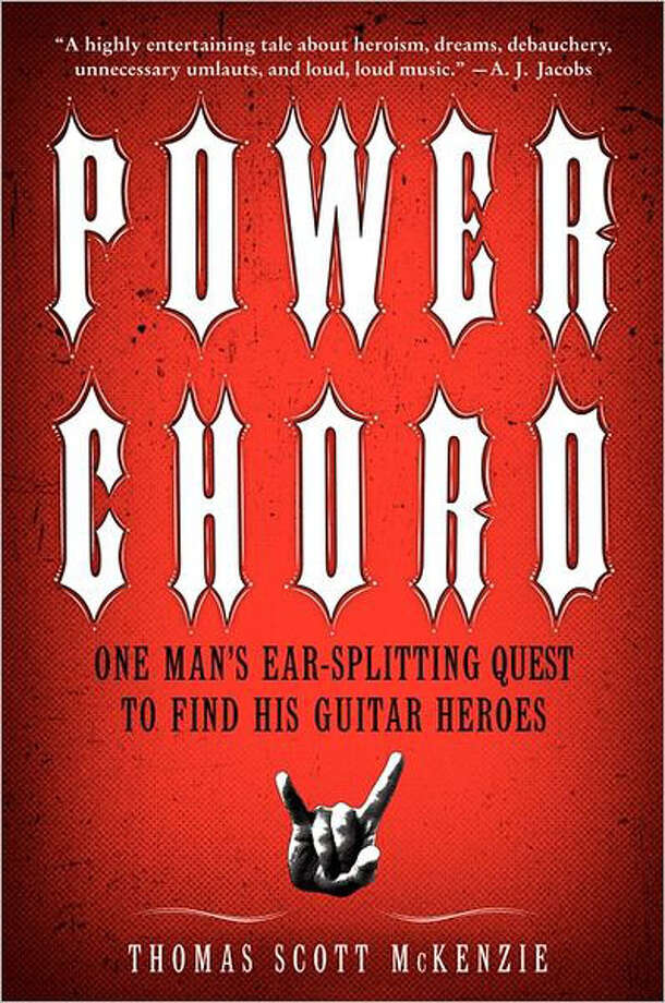 "Thomas Scott McKenzie, a software project manager and lifelong hard rock fan from middle America, took his rock obsession to extremes, embarking on a cross-country expedition to meet and learn from the guitar gods of his youth — guys like Ace Frehley of KISS, Glenn Tipton of Judas Priest and Phil Collen of Def Leppard.  The result is ""Power Chord: One Man's Ear-splitting Quest to Find His Guitar Heroes,"" an entertaining travelogue of sorts that hits all the right notes."