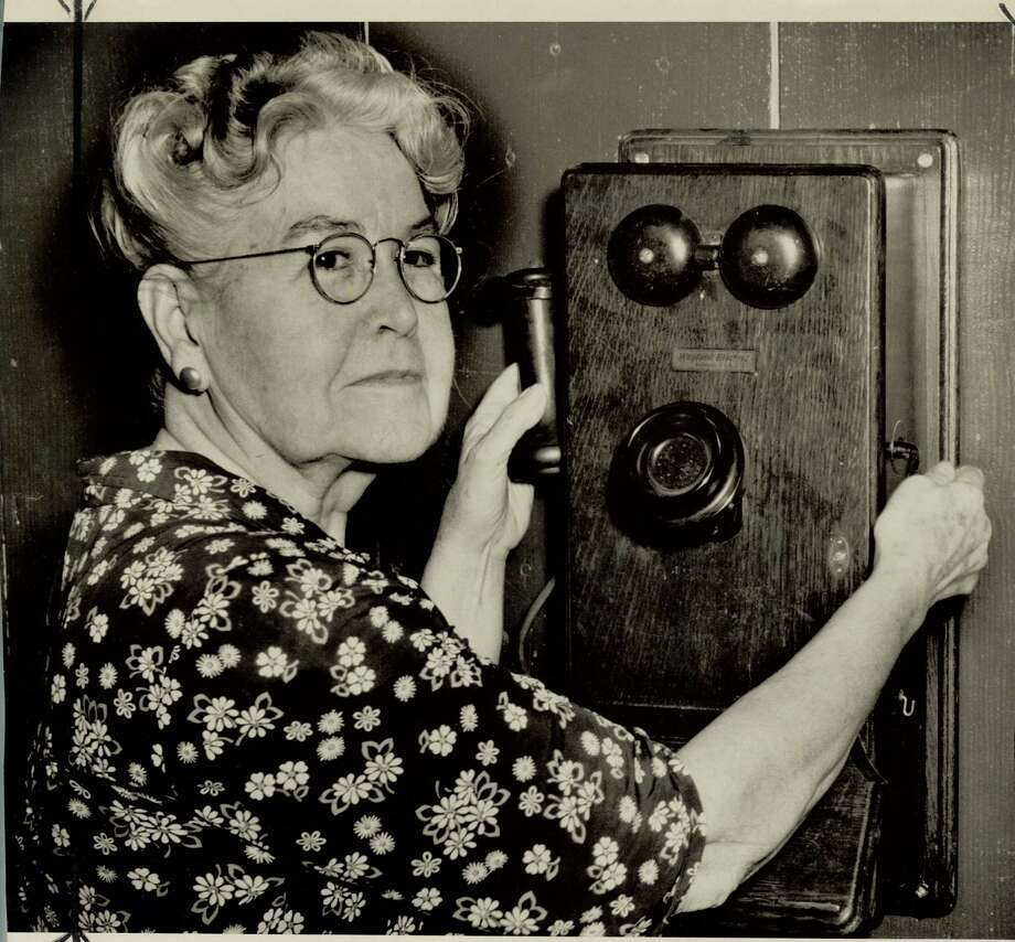Miss Nora started working for Southwestern Bell Telephone company in 1898 as a switchboard operator on vintage phones shown. Photo: Enterprise File Photo