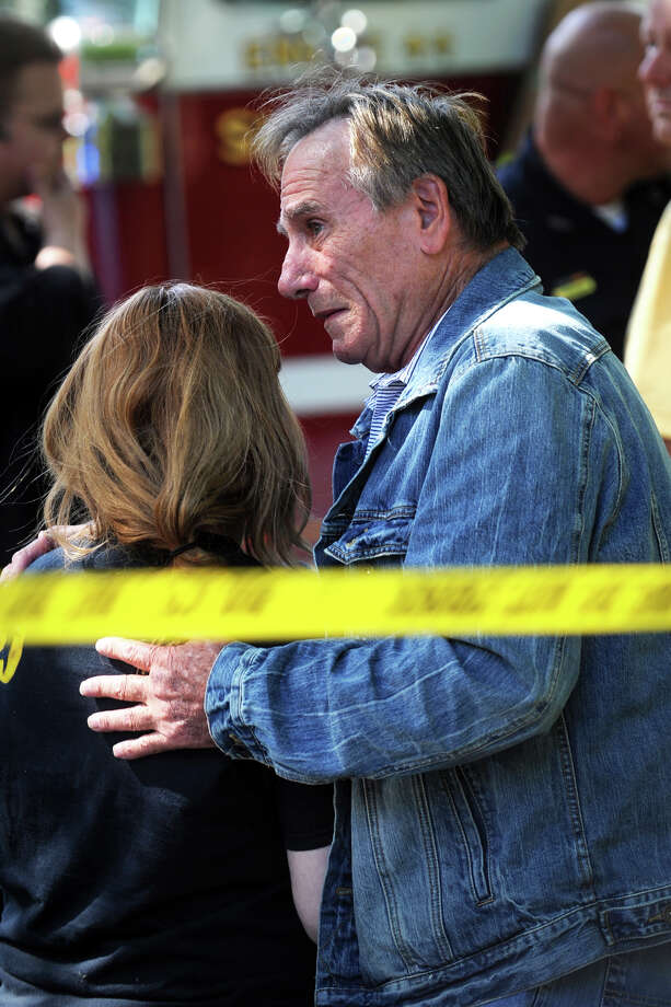 Forbes Duguid consoles a family member following an explosion inside the Duguid home at 67 Wopowog Trail, in Shelton, Conn., Sept. 10th, 2012. Photo: Ned Gerard / Connecticut Post