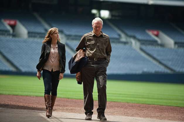 "Clint Eastwood plays an aging baseball scout, and Amy Adams plays his lawyer daughter in ""Trouble With the Curve."" Photo: Warner Bros. Pictures / Warner Bros. Pictures"