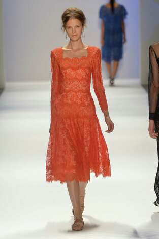 Bright lace such as that in Tadashi Shoji's collection has emerged early as a spring trend at New York Fashion Week. Photo: Getty Images / 2012 Getty Images