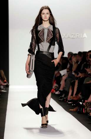 The BCBG MAX AZRIA Spring 2013 collection is modeled during Fashion Week in New York,  Thursday, Sept. 6, 2012. (AP Photo/Richard Drew) Photo: Richard Drew, STF / AP