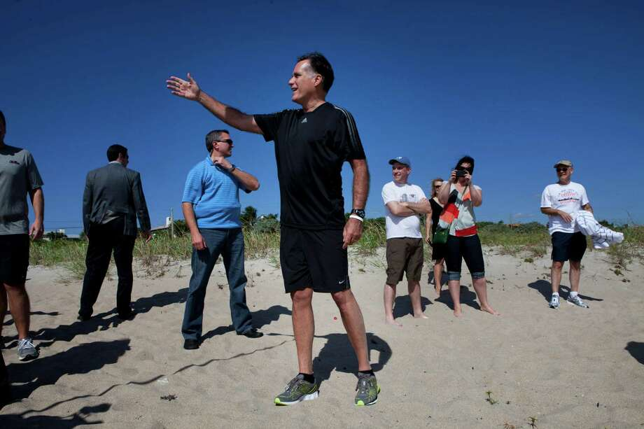 Mitt Romney, the Republican presidential candidate, at a beach for a football game between his staff and some of the traveling press in Delray Beach, Fla., Oct. 21, 2012. Having rejected public financing for the general election, Romney and President Barack Obama are free to spend as much money in the closing 16 days as they can raise. Photo: RICHARD PERRY, New York Times / NYTNS