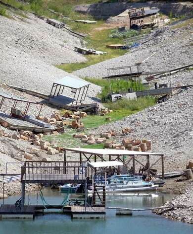 Boat docks once floating over deep water are stranded high and dry Wednesday Aug. 29, 2012 on Medina Lake. The Texas Water Development Board reported Wednesday, via its website, the lake is 13.88 percent full and is 63.34 feet below normal pool elevation. Photo: William Luther, San Antonio Express-News / © 2012 San Antonio Express-News