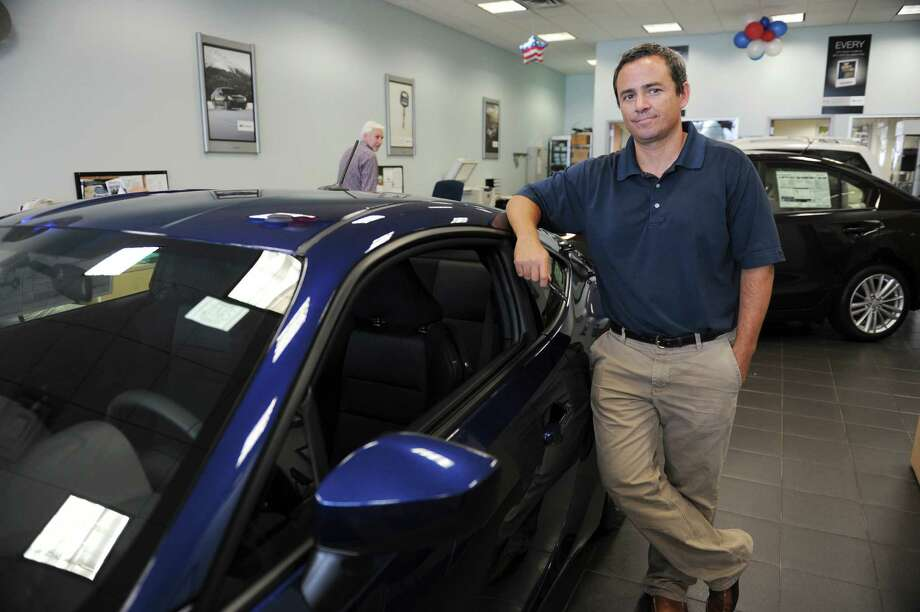 George D'Angelo, the general manager of Subaru Kia of Stamford,  Tuesday, Sept. 4, 2012. Photo: Helen Neafsey / Greenwich Time