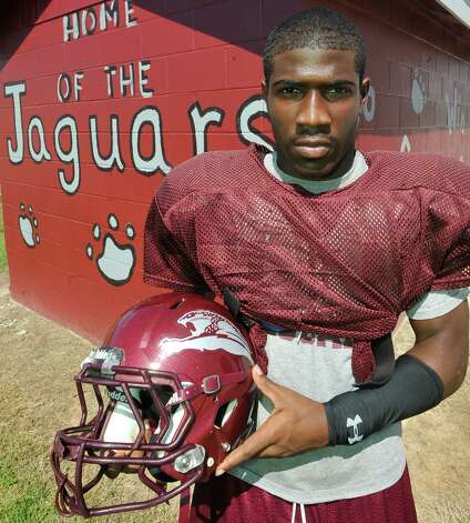 Central football player Nicalus Rhone is known for being funny and smart. He helps his teammates with homework, and he is No. 2 student in the senior class at Central Medical Magnet High School. Dave Ryan/The Enterprise Photo: Dave Ryan