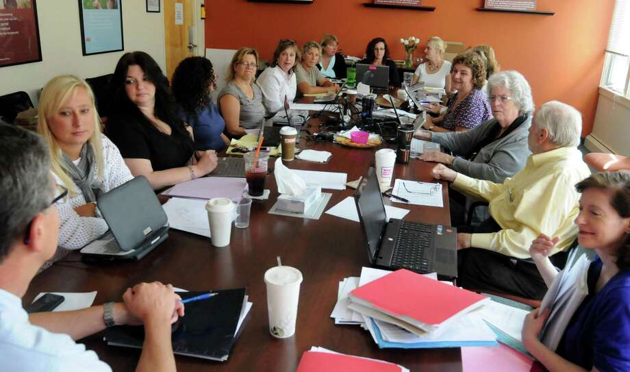 Regional Hospice and Home Care of Western Connecticut holds a weekly team meeting in their office in Danbury on Tuesday, Aug. 21, 2012. Photo: Lisa Weir
