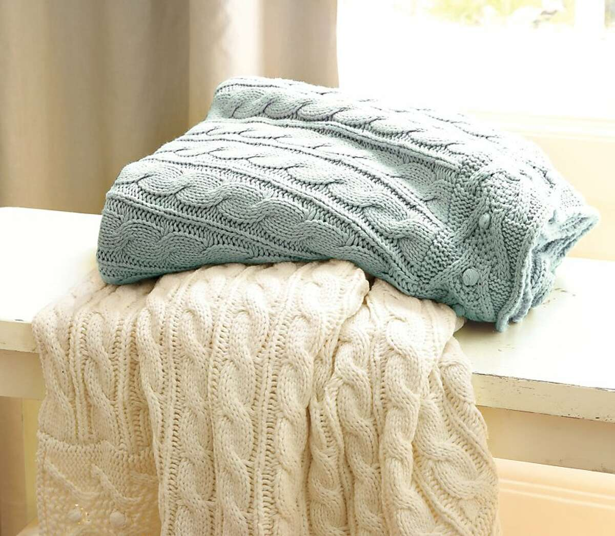 Less: $79 Cable-Knit Throw from Pottery Barn (potterybarn.com)